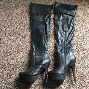 Over the knee leather heeled boots